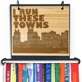 Engraved Bamboo BibFOLIO+™ Race Bib and Medal Display I Run These Towns