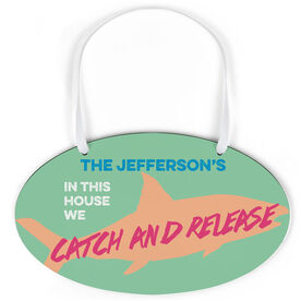 Fly Fishing Oval Sign - In This House We Catch and Release Carribean