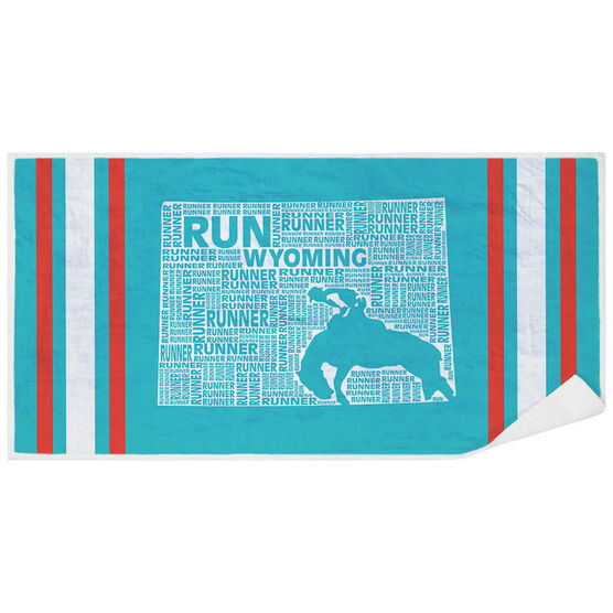 Running Premium Beach Towel - Wyoming State Runner