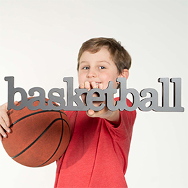Boy Holding Up Wood Words Basketball