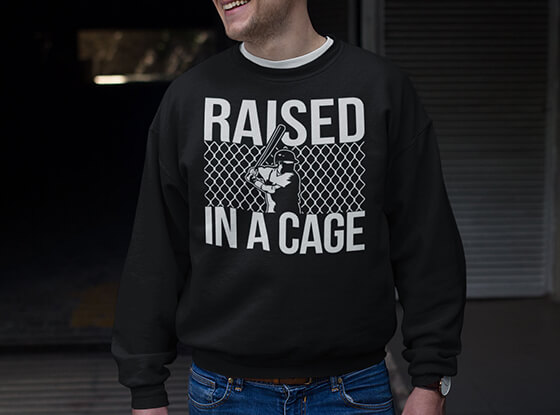 Guy Wearing Raised In A Cage Crew Neck Sweatshirt