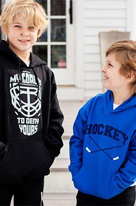 Boys Wearing Hockey Hooded Sweatshirts